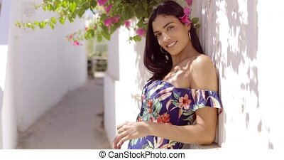 Charming brunette with flowers in hair - Portrait of...