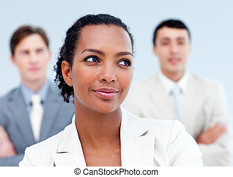 Charming business people standing with folded arms