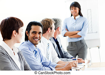 Charming businessman looking at the camera in a meeting