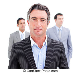 Charming businessman posing in front of his team