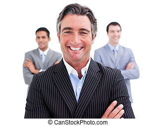 Charming businessman standing with his team