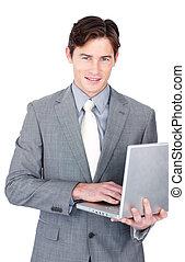 Charming businessman using a laptop