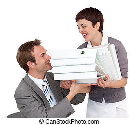 Charming Businesswoman bringing a pile of folders to her colleague in the office