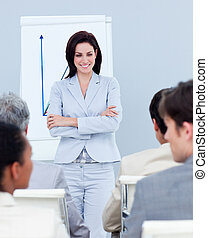 Charming businesswoman doing a presentation