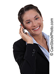 charming businesswoman talking on her cell phone