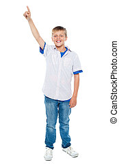 Charming casual boy pointing upwards