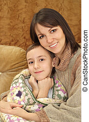 Charming Caucasian mama with her son
