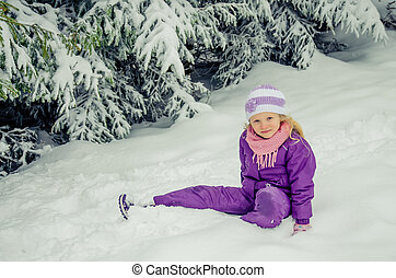 charming child in winter nature