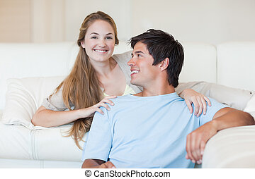 Charming couple watching television
