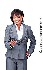 Charming ethnic businesswoman on phone against a white...