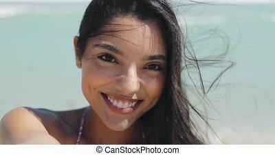 Charming ethnic woman on windy beach - Headshot of beautiful...