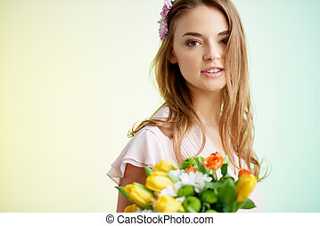 Charming fairy - Cute female with spring flowers looking at...