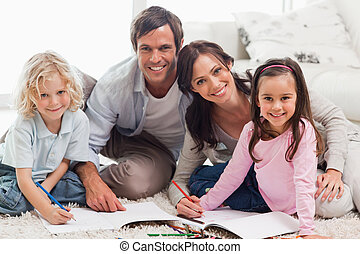 Charming family drawing together in a living room