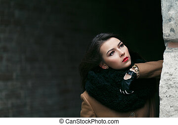 Charming fashion female modell in a coat - fashion stylish...