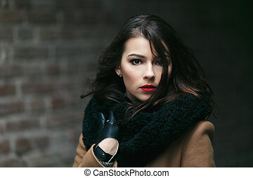 Charming fashion female modell in a coat. - beautiful young...