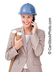 Charming female architect on phone standing