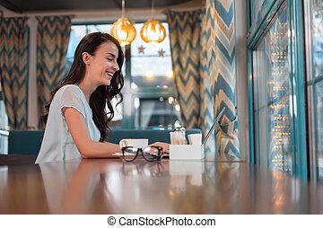Charming female freelancer concentrating on work