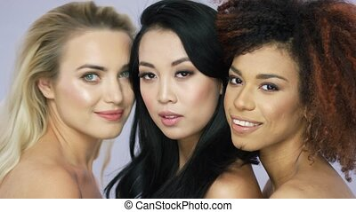 Charming female models posing together - Portrait of three...