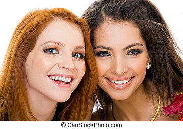 Charming friends - Faces of two young ladies looking at...