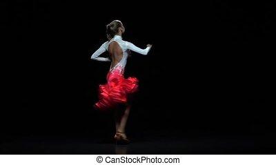 Charming girl dancing elements rumba, dark background. Slow motion