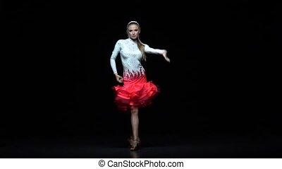 Charming girl dancing elements samba, dark background. Slow motion