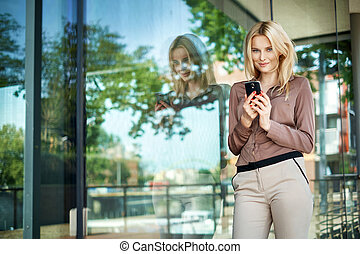 charming girl holding a new generation cell phone