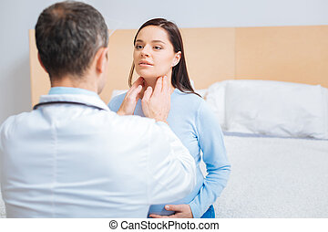 Charming girl looking attentively at specialist