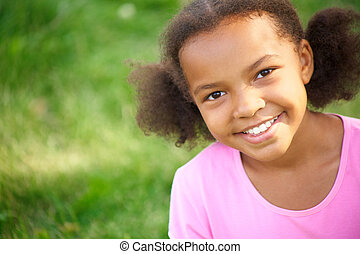 Charming girl - Portrait of cute girl looking at camera and...