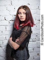 Charming girl posing in studio