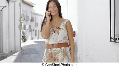 Charming girl talking phone at street - Stylish pretty...