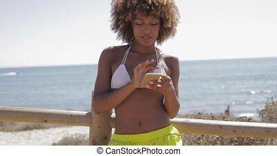 Charming girl using smartphone while training - Beautiful...