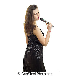 Charming girl with microphone in black dress