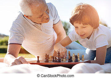 Charming intelligent child learning rules of the game