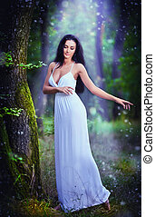 Charming lady in forest