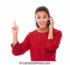 Charming lady talking on her phone while smiling