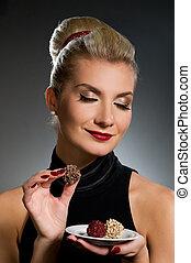 Charming lady tasting chocolate