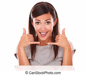 Charming lady with phone gesture looking at camera