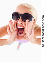 Charming lady with sunglasses in high spirits in a studio