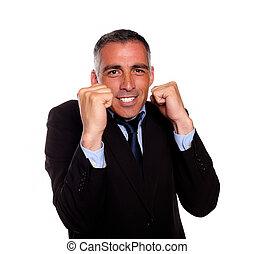 Charming latin businessman boxing