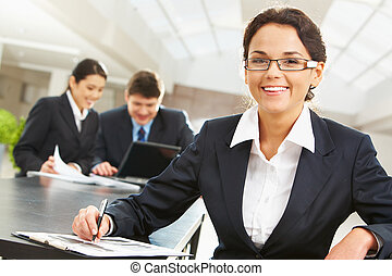Charming leader - Portrait of happy leader with two...