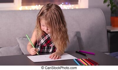charming little blonde girl in red checkered dress painting with colorful pencils. childhood, toddler, daughter. FullHD footage