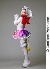 Charming little girl posing in dance costume