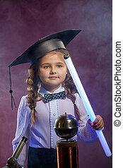 Charming little girl posing with lamp in lab