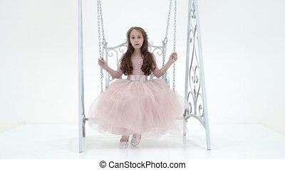 Charming Long Haired Girl in Nice Dress Swinging on Elegant ...
