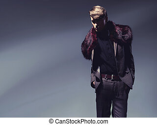 Charming man showing autumn fashion