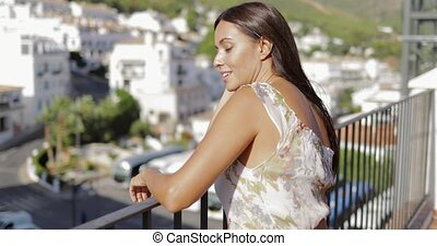 Charming model enjoying sunlight on balcony - Young...