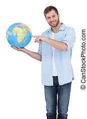 Charming model holding a globe