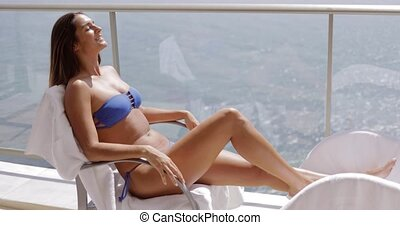 Charming model sunbathing on hotel balcony - Young excited...