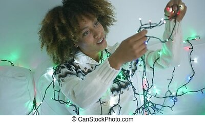 Charming model untangling garland - Content young ethnic...