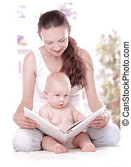 charming mom reading a book to her baby